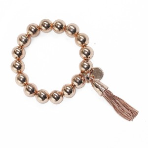 Stretchy Ball and Tassel Bracelet rose gold colour
