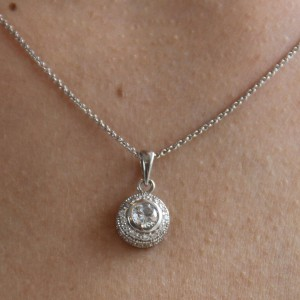 Silver Solitaire And Cz Surround Pendant
