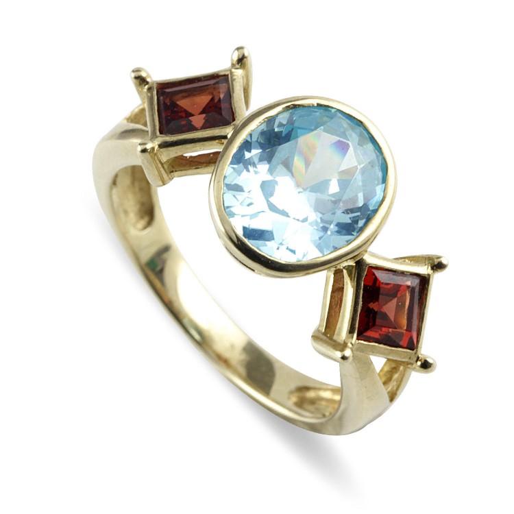 9K Yellow Gold Garnet And Blue Topaz Ring